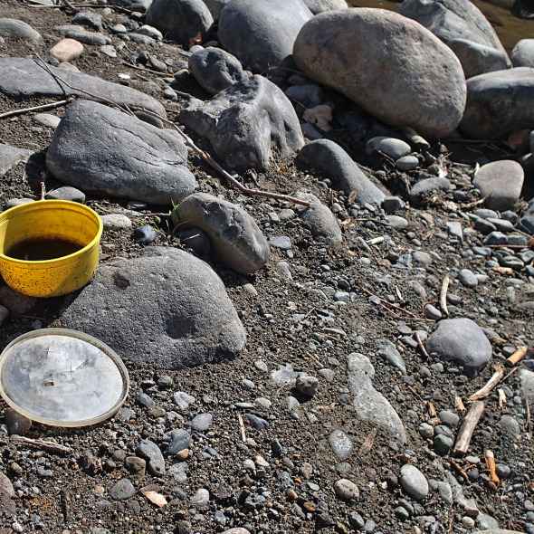 Litter on the riverbed.